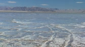 hydrology : Panoramic view of the barren environmental landscape of a dry salt lake Stock Footage