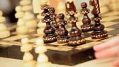 chess board : Wooden chess pieces being played on a board in close-up