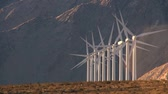 wind : Rows of wind turbines producing clean alternative energy in barren landscape