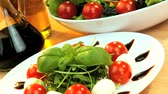 уксус : Delicious selection of fresh crisp salad,mozarella cheese & oils making a healthy nutritious meal Стоковые видеозаписи