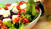 уксус : Tempting selection of fresh crisp salad,mozarella cheese & oils making a healthy nutritious meal