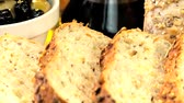 уксус : Healthy wholegrain bread freshly sliced & ready to eat with olives & dipping oil Стоковые видеозаписи
