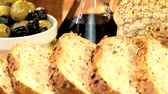 уксус : Tasty fresh wholegrain bread sliced ready to eat & served with olives & healthy oils Стоковые видеозаписи