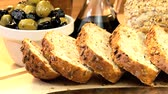 уксус : Delicious healthy wholegrain bread freshly sliced & ready to eat with olives & dipping oil