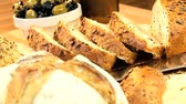уксус : Selection of fresh organic breads baked with healthy nuts & seeds and served with olives & tasty olive oil