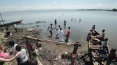chrzest : KENYA, KISUMU - MAY 20, 2017: Baptizing of African people in the lake. Men and women come into the water.