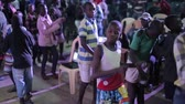 south american : KENYA, KISUMU - MAY 20, 2017: Big group of African children dancing inside together, listen music and singing. Stock Footage
