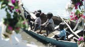 shuffle : KENYA, KISUMU - MAY 20, 2017: Group of African children sitting in the boat and looking on the water of the sea.