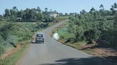 KENYA, KISUMU - MAY 20, 2017: View through a windshield from inside a car. Van is going through a country road near African village. Stock Footage