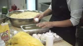 separating : In the kitchen, chef separates the whites from the yolks of eggs.