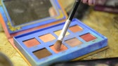 румяна : Close-up shooting of palette with taking rouge with brush for make-up.