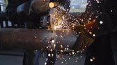 instalator : Worker Cutting Steel Pipe with Angle Grinder