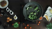 non stick : Broccoli frying in a pot with oil Stock Footage
