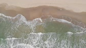 Waves and beach looked from above Wideo