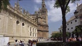 Seville, Spain-august 7,2017: People walk through and admire the famous Seville Cathedral in Spain during a sunny day.