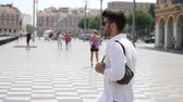 opalanie : Attractive fit athletic young man soaking in the sun in seaside city of Nice, France on the French Riviera