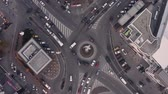counterclockwise : Top down view of roundabout, late evening overhead aerial drone flight