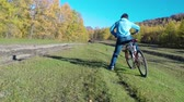 amatör : Women rides a Bicycle along a forest road. slow motion