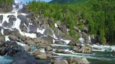 river rapids : Waterfall Uchar. The height of the dam is about 300-350 m. The height of the water fall is about 160 m. Altai mountains, Siberia Russia. Slow motion.