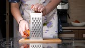 Rubbing boiled carrots. The girl rubs boiled carrots in the kitchen. Medium shot Stockvideo