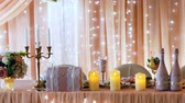 událost : Beautifully decorated peach color table newlyweds. Closeup