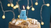 výrazný : Birthday cake with 4 number candle on blue backgraund. Candles blow out. Slow motion and close-up