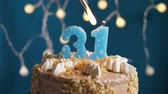 výrazný : Birthday cake with 31 number burning candle by lighter on blue backgraund. Candles are set on fire. Slow motion and close-up view Dostupné videozáznamy