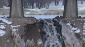 avignon : Little waterfall under the bridge on the background of lake at winter wather Stock Footage