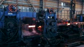 industrial : Ironworks plant. Burning Hot Billet moving through Machines