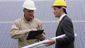 solar energy power : Technician and Engineer meeting at solar power station Stock Footage