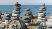 Stacked stones on rocky coast