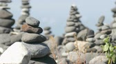 Many stacked cairns at the coast