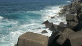 waves crashing on rocky coastline, Coastal protection with large rocks