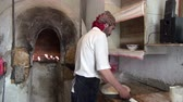 tandoor : A man prepares bread in an Uzbek bakery.