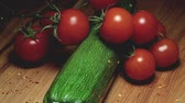смаковать : Zucchini cherry tomatoes chilli seeds on wooden cutting board Стоковые видеозаписи