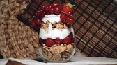 müsli : Currants, strawberries, raspberries, cereals on cutting board Stok Video
