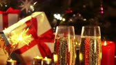 Glasses with champagne - Christmas decoration with burning sparkler - 4 k Стоковые видеозаписи