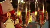 Close up of glasses with champagne - New Year and Christmas decoration - 4 k Стоковые видеозаписи