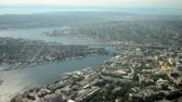 cargo container : Aerial view following ship canal over university to interstate bridge Stock Footage