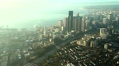 nowoczesne : Aerial perspective of tall buildings on sunny and smoggy afternoon