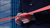 ribbon : Red ribbon cutting: Hand cutting a red ribbon for inauguration Stock Footage