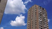 establishing shot : Old Residential Building Skyscrapers with Blue Summer Sky and White Clouds Stock Footage