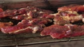 schab : Grilling pork chops on barbecue, tiny juicy meat slices roasting on bbq grid plate