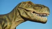 t rex : NOVI SAD, SERBIA - AUGUST 7, 2016: Tyrannosaurus life size model of prehistoric animal in theme entertainment Dino Park. T-rex was one of the largest land carnivores of all time. Stock Footage