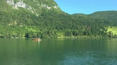 surrounding environment : View on the Bohinj lake surrounding area from sailing boat Stock Footage