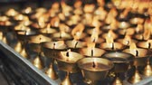 religious symbols : burning candles in a Buddhist temple in Kathmandu