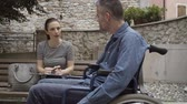 querido : A social worker meeting with a clipboard, a handicap and assistance concept Stock Footage