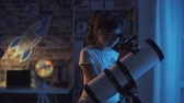 stargazing : Happy young girls stargazing with a telescope, they are learning astronomy together at home