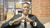 sonhar : Handmade Heart Sign by Black Businessman