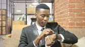 downloading : Black Businessman Using Smartwatch, Office